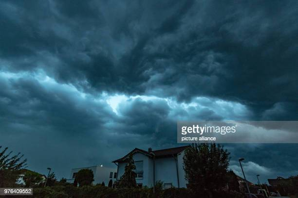 Dark storm clouds move above a residential area in the evening Photo Armin Weigel/dpa
