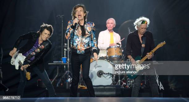 Guitarist Ron Wood singer Mick Jagger drummer Charlie Watts and guitarist Keith Richards on stage at a concert by the Rolling Stones during their...