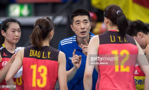 Volleyball women's Nations League match between Germany and China at the Porsche Arena China's head coach Jiajie An speaks with players Linyu Diao...