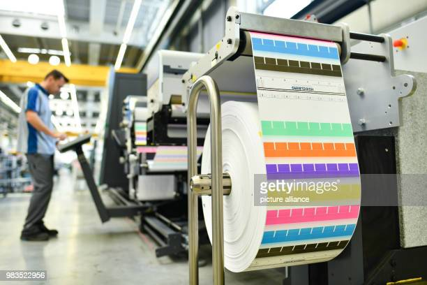 An employee standing at a digital label printing machine of the type 'Gallus Labelfire' in the workshop of Heidelberger Druckmaschinen AG The company...