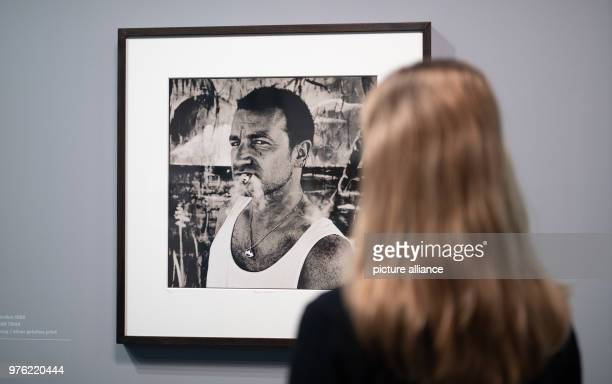A woman looks at the exhibition 'Anton Corbijn The Living and the Dead' at the Bucerius Kunst Forum a portrait of U2 singer Bono Photo Daniel...