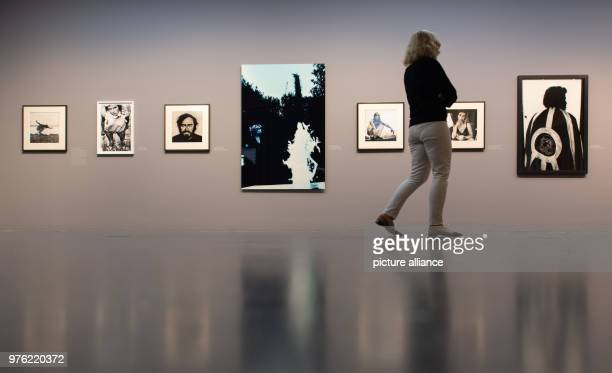 A woman walsk through the exhibition 'Anton Corbijn The Living and the Dead' at the Bucerius Art Forum Photo Daniel Reinhardt/dpa