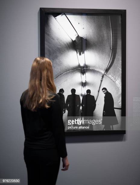 A woman watches at the exhibition 'Anton Corbijn The Living and the Dead' at the Bucerius Art Forum a Photograph of the band Joy Division Photo...