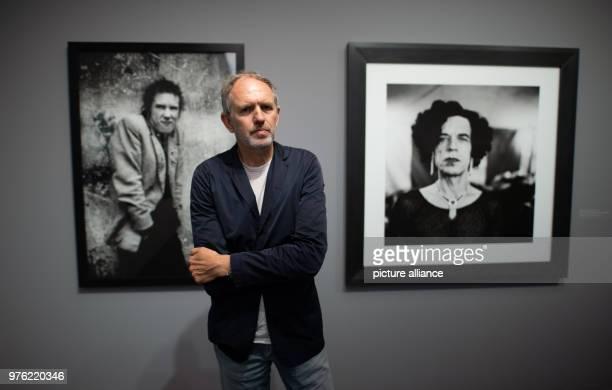 The Dutch photographer Anton Corbijn standing in the exhibition 'Anton Corbijn ' The Living and the Dead 'at the Bucerius Kunst Forum in front of his...