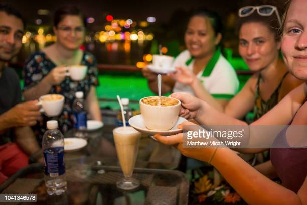 june 2018 hanoi, vietnam - travelers try out a hanoi specialty, egg coffee. - friends television show stock pictures, royalty-free photos & images