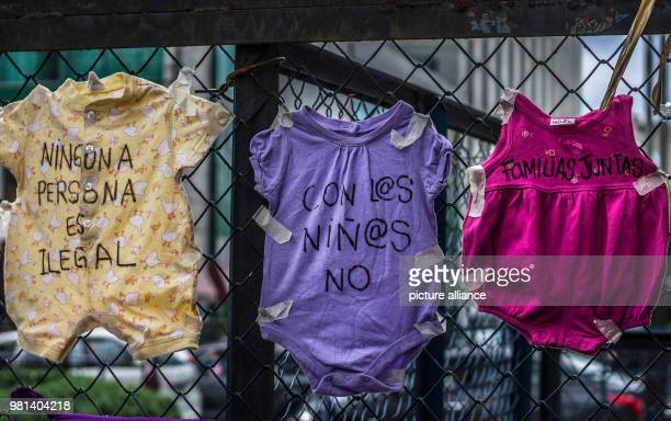 'No person is illegal' 'Families belong together' and 'Not with the children' is written on rompers during a protest against the migration policies...