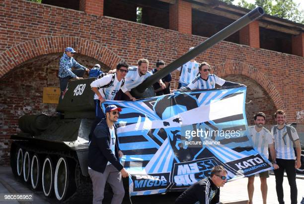 21 June 2018 Nizhny Novgorod Russia Soccer World Cup Argentina vs Croatia Group Stage Group D 2nd Game Day Fans of Argentina pose on a Russian tank...