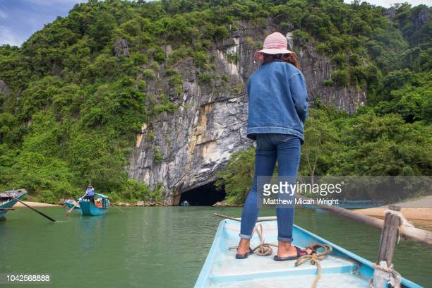 June 2018 Phong Nha, Vietnam - Local boats take passengers into limestone caves in the Phong Nha Heritage Area in Vietnam.