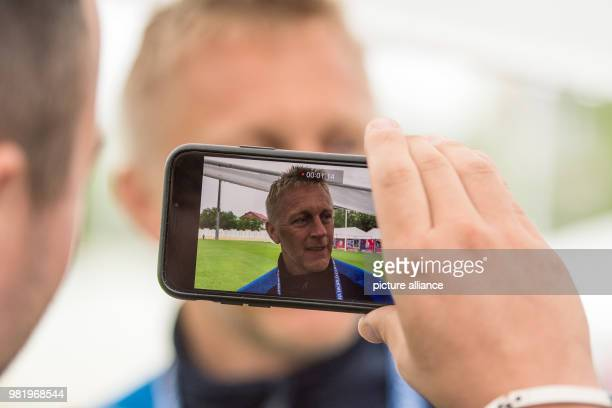 Soccer FIFA World Cup training Iceland Coach Heimir Hallgrimsson is being filmed by a journalist during an interview On Tuesday Iceland faces Croatia...