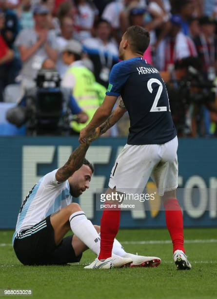 Football World Cup France vs Argentina at the Kazan Arena Nicolas Otamendi of Argentina and Benjamin Pavard of France after the match Photo Cezaro De...