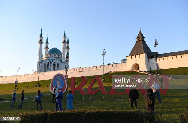 People take pictures in front of a lettering reading 'Kazan' outside the mosque Kul Sharif Photo Andreas Gebert/dpa