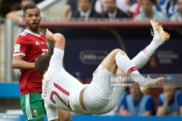 World Cup Portugal vs Morocco preliminary round Group B 2nd match day in the Luzhniki Stadium Portugal's Cedric Soares and Morocco goalkeeper Ahmed...