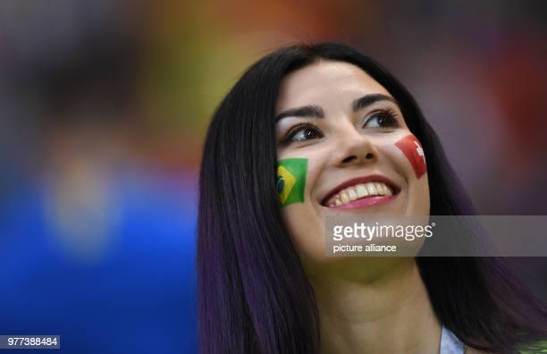 June 2018, Russia, Rostow am Don, Soccer, FIFAWorld Cup, Group E, Brazil vs Switzerland at the Don Stadium: A spectator painted the national flags...