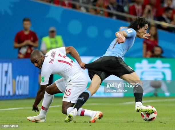 Fußball Football World Cup Uruguay vs Portugal at the Fisht Stadium Edinson Cavani of Uruguay and Ricardo of Portugal vie for the ball Photo...