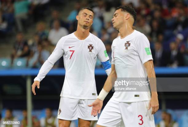 Fußball Football World Cup Uruguay vs Portugal at the Fisht Stadium Cristiano Ronaldo of Portugal and Pepe of Portugal react after a missed scoring...
