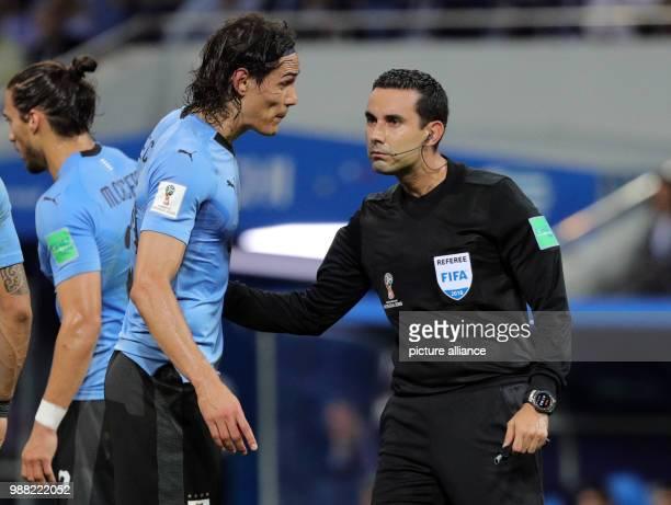 Fußball Football World Cup Uruguay vs Portugal at the Fisht Stadium Edinson Cavani of Uruguay on conversation with referee Cesar Ramos from Mexiko...