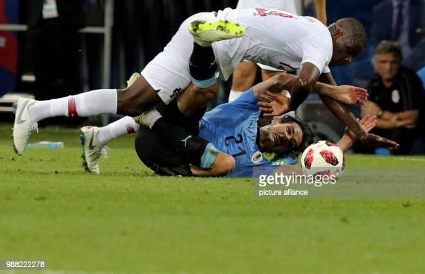 Fußball Football World Cup Uruguay vs Portugal at the Fisht Stadium Edinson Cavani of Uruguay and William Carvalho of Portugal vie for the ball Photo...