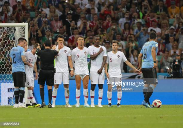 Fußball Football World Cup Uruguay vs Portugal at the Fisht Stadium Luis Suarez of Uruguay taking a freekick in front of Raphael Guerreiro of...
