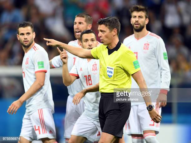 Soccer FIFA World Cup Group B Portugal vs Spain at the Sochi Stadium Italian referee Elenito di Liberatore Spain's Nacho and Gerard Pique Photo...