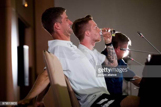 Soccer World Cup press conference Marco Reus Thomas Mueller and press spokesman Jens Grittner during a press conference at the team hotel Photo...