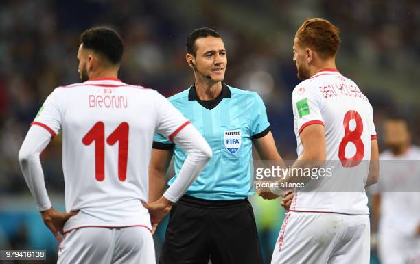 Soccer World Cup Tunisia vs England group stages group G Volgograd Stadium Referee Wilmar Roldan Perez speaking to Tunisia's Dylan Bronn and...