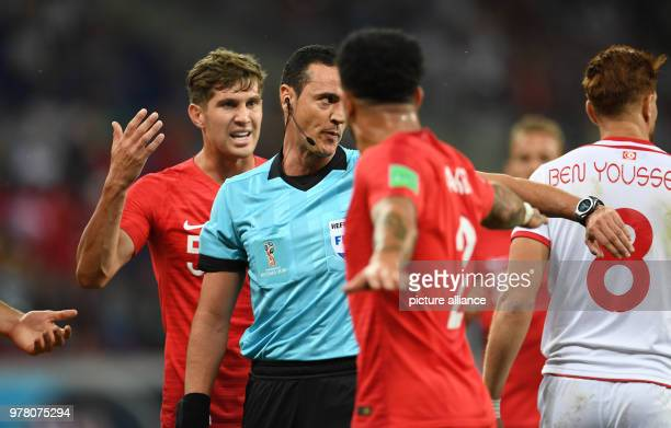 Soccer World Cup Tunisia vs England preliminary round group G Volgograd Stadium Match referee Wilmar Roldan Perez awarding a penalty kick after a...