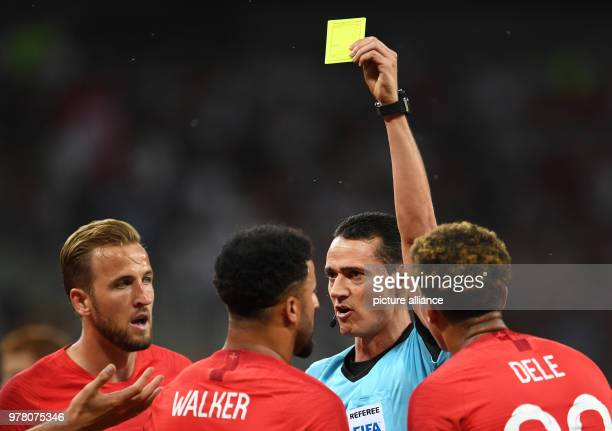 Soccer World Cup Tunisia vs England preliminary round group G Volgograd Stadium Match referee Wilmar Roldan Perez showing England's Kyle Walker the...