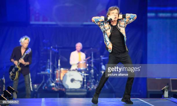 Singer Mick Jagger performs during a concert of the Rolling Stones during their European tour 'no filter' at the Mercedes Benz Arena Behind him are...