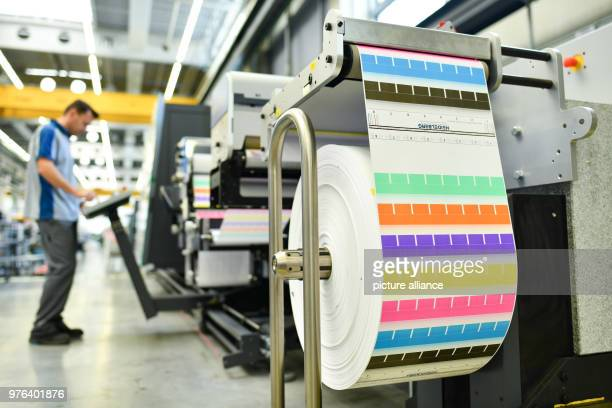 An employee stands at a printing machine type 'Gallus Labelfire' a label printer at the factory of the Heidelberger Druckmaschinen AG The business...
