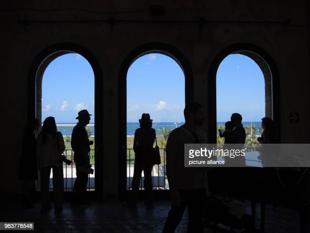 June 2018,Italy, Palermo: Visitors of the Manifesta 12 stand in front of windows of the Palazzo Forcella De Seta in Palermo. The 12th edition of the...