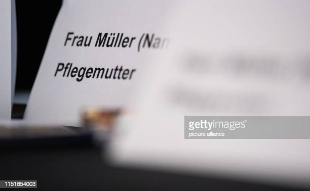 """June 2019, Baden-Wuerttemberg, Eßlingen: A sign with the inscription """"Frau Müller Pflegemutter"""" is standing on a table during a press conference. In..."""