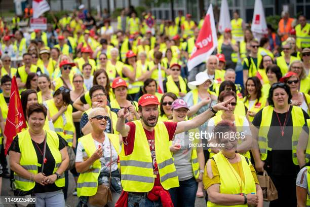 14 June 2019 BadenWuerttemberg Neckarsulm Striking Kaufland employees stand in front of the group's headquarters in Neckarsulm After the fruitless...