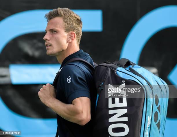 14 June 2019 BadenWuerttemberg Stuttgart Tennis ATPTour Stuttgart singles men quarter finals Fucsovics Raonic Marton Fucsovics leaves the court after...