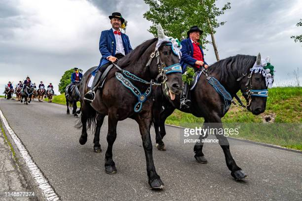 Hubert Aiwanger Minister of Economic Affairs of Bavaria rides a horse at the Kötztinger Whitsun Ride The procession with around 900 riders is one of...