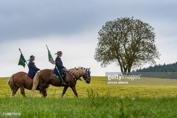 Participants of the Kötztinger Whitsun ride with their horses The procession with around 900 riders is one of the oldest Bavarian customs events The...