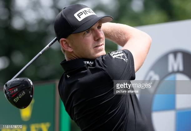 Golf European Tour International Open singles men 4th round Professional golfer Matt Wallace from England looks after his tee shot Photo Sven...