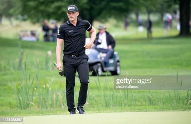 Golf European Tour International Open singles men 4th round Professional golfer Matt Wallace from England enters the green Photo Sven Hoppe/dpa