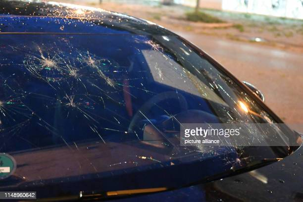 ILLUSTRATION A window pane of a car damaged by hail in a storm Photo Felix Hörhager/dpa