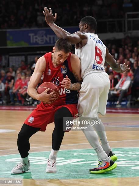 Basketball Bundesliga FC Bayern Munich RASTA Vechta championship round semifinal 3rd matchday Bavaria's Stefan Jovic fights Rastas Josh Young for the...