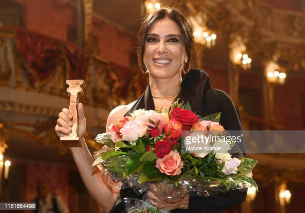 Nadine Labaki Lebanese director holds her award in her hands at the Peace Prize of German Film The Bridge in the Cuvilliés Theater Labaki was awarded...