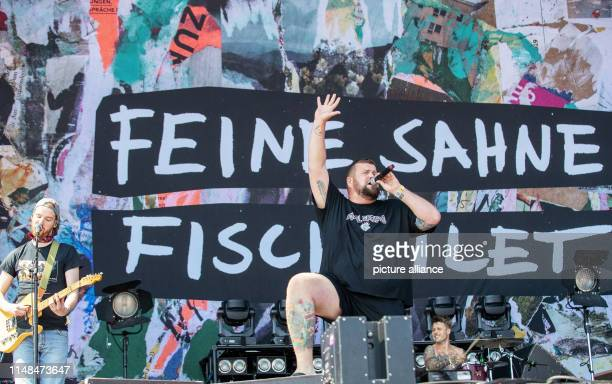 Jan Monchi Gorkow singer of the German punk band Feine Sahne Fischfilet stands on stage at the openair festival Rock im Park and sings The music...