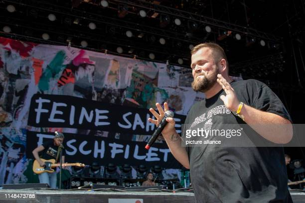 Jan Monchi Gorkow singer of the German punk band Feine Sahne Fischfilet is on stage at the openair festival Rock im Park and smiles The music...