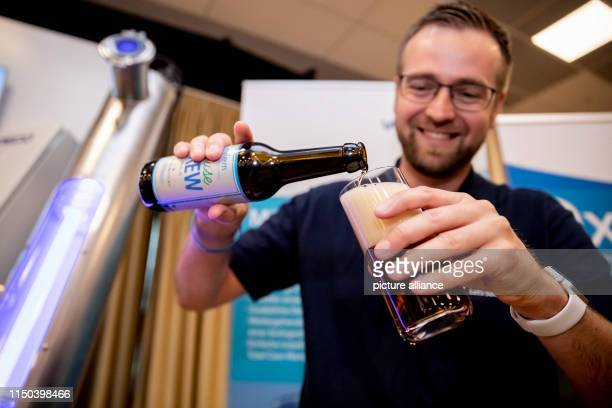 Jens Scheideler, Product Manager Water Reuse at Xylem, presents beer brewed from wastewater at the IWA Water Reuse 2019 conference. Photo: Christoph...