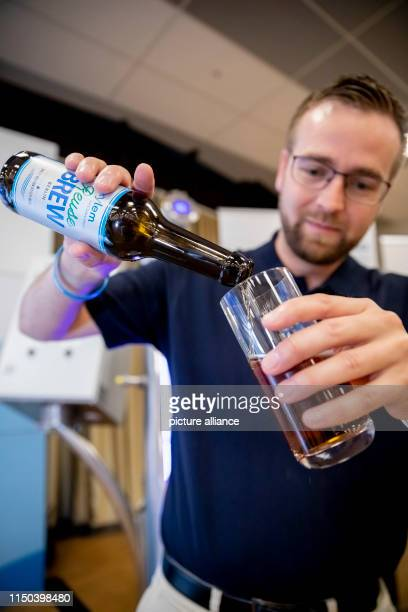 ILLUSTRATION Jens Scheideler Product Manager Water Reuse at Xylem presents beer brewed from wastewater at the IWA Water Reuse 2019 conference Photo...