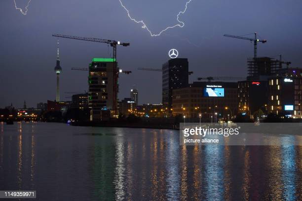 Lightning flashes during a summer storm over the Berlin skyline on