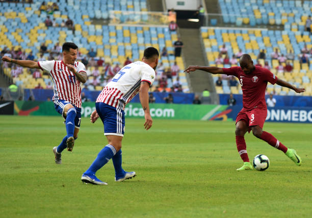 Soccer Copa América Paraguay Qatar preliminary round Group B Matchday 1 at Estadio do Maracana Abdelkarim Hassan of Qatar plays the ball Bruno Valdez...