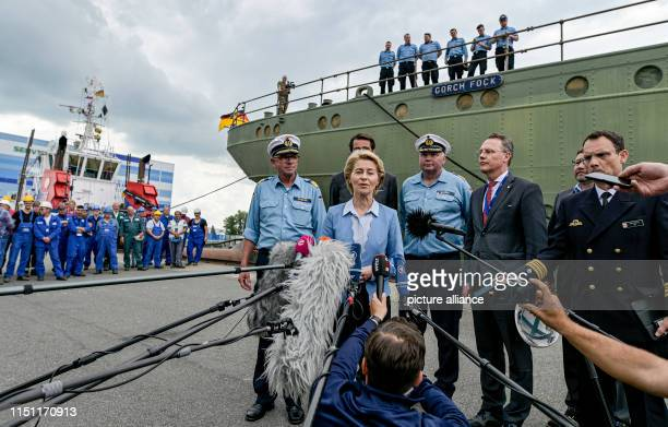Ursula von der Leyen Federal Minister of Defence answers questions from journalists between crew members in front of the shipyard employees of the...