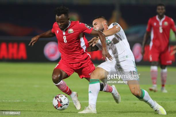 Algeria's Andy Delort and Kenya's Johanna Omolo battle for the ball during the 2019 Africa Cup of Nations Group C soccer match between Algeria and...