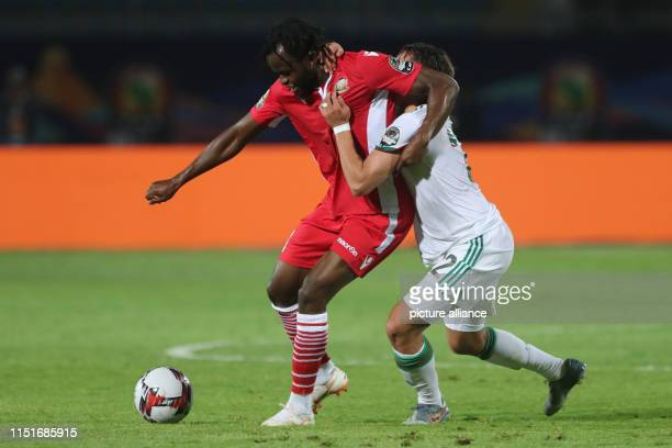 Algeria's Ismael Bennacer and Kenya's Johanna Omolo battle for the ball during the 2019 Africa Cup of Nations Group C soccer match between Algeria...