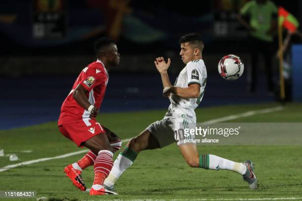Algeria's Youcef Atal and Kenya's Ayub Timbe battle for the ball during the 2019 Africa Cup of Nations Group C soccer match between Algeria and Kenya...